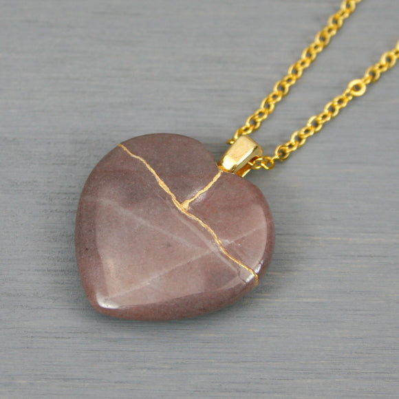 Purple aventurine broken heart pendant with kintsugi repair on chain necklace