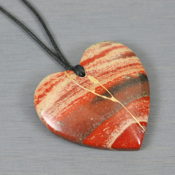 Rainbow jasper heart pendant with kintsugi repair on black cotton cord