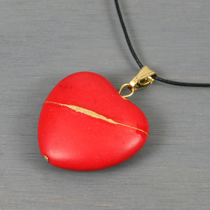 Red howlite broken heart pendant with kintsugi repair on black cotton cord