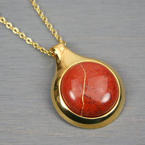 Red jasper kintsugi pendant in a gold setting on chain