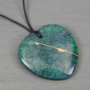 Dark green dragon veins agate broken heart pendant with kintsugi repair on black cotton cord