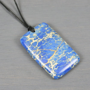 Blue magnesite pendant with kintsugi repair on black cotton cord