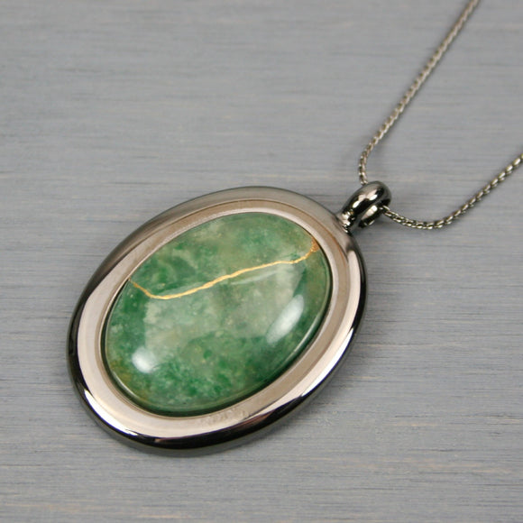 African jade kintsugi pendant in a gunmetal setting on chain