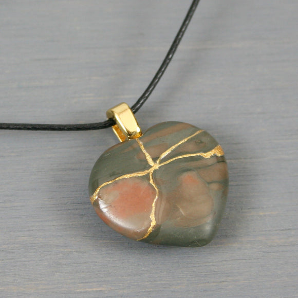 Brown and gray stone broken heart pendant with kintsugi repair on black cotton cord