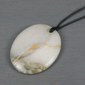 Black and gray marble pendant with kintsugi repair on black cotton cord