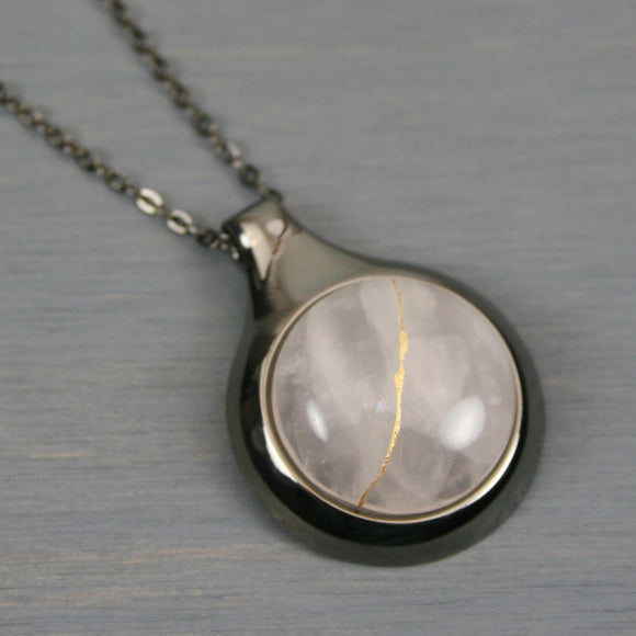 Rose quartz kintsugi pendant in a gunmetal setting on chain
