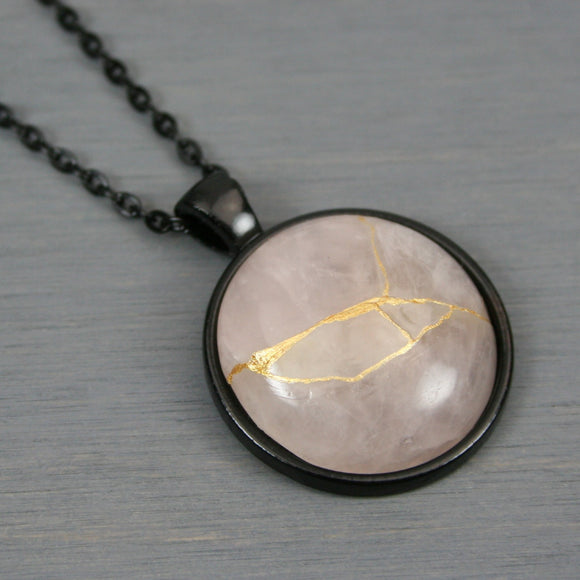 Rose quartz kintsugi pendant in black setting on chain