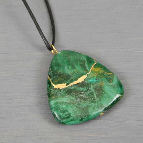 African jade triangle pendant with kintsugi repair on black cotton cord