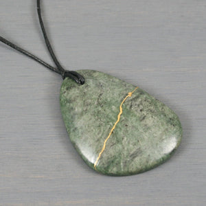 Green marble pendant with kintsugi repair on black cotton cord