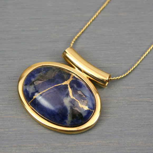 Sodalite kintsugi pendant in a gold setting on chain