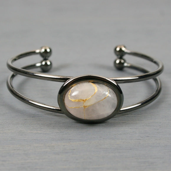 Rose quartz kintsugi bracelet in a gunmetal cuff setting