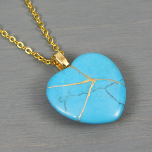 Turquoise magnesite broken heart pendant with kintsugi repair on chain necklace