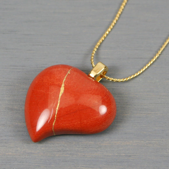 Red jasper broken heart pendant with kintsugi repair on chain necklace