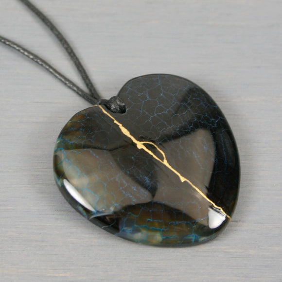 Black dragon veins agate broken heart pendant with kintsugi repair on black cotton cord