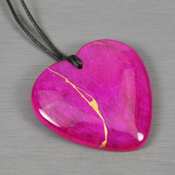 Pink agate broken heart pendant with kintsugi repair on black cotton cord