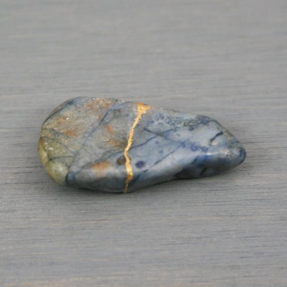 Small kintsugi repaired blue dumortierite tumbled stone