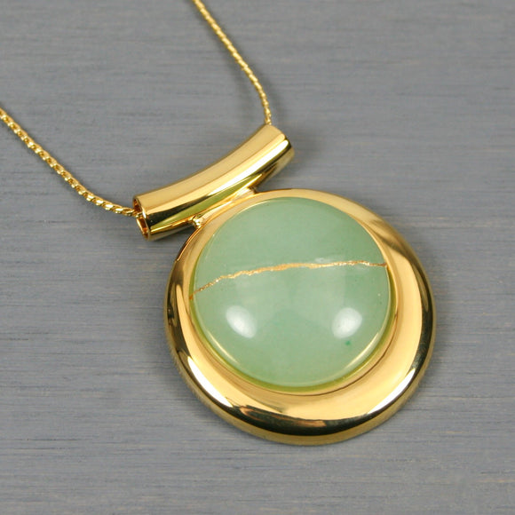Green aventurine kintsugi pendant in a gold setting on chain