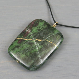 Ruby in zoisite pendant with kintsugi repair on black cotton cord