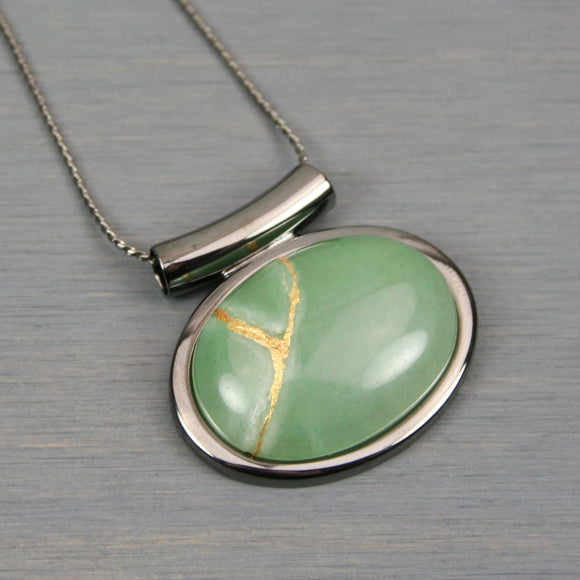 Green aventurine kintsugi pendant in a gunmetal setting on chain