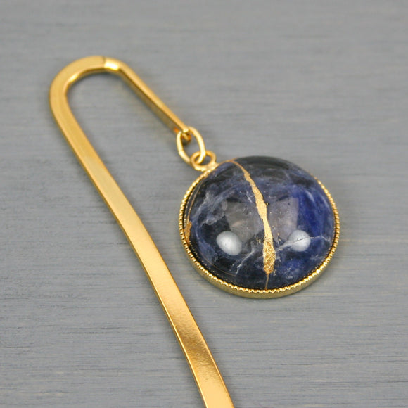 Sodalite with kintsugi repair on gold plated steel bookmark