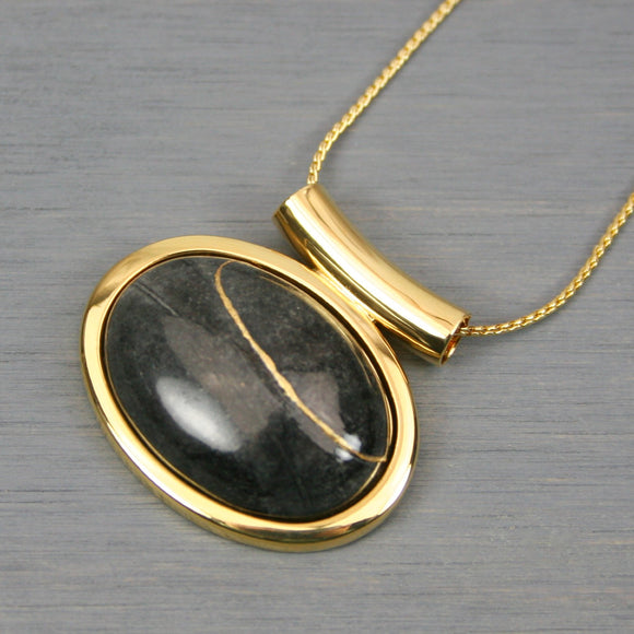 Picasso jasper kintsugi pendant in a gold setting on chain