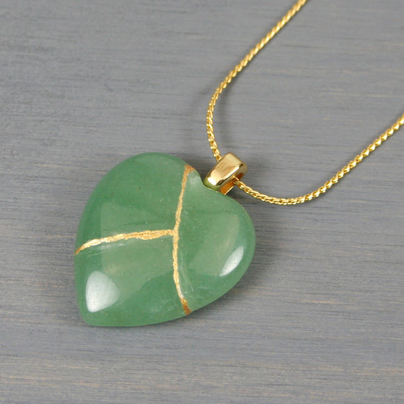 Green aventurine broken heart pendant with kintsugi repair on chain necklace