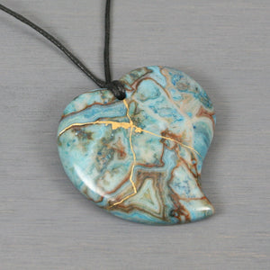 Blue crazy lace agate broken heart pendant with kintsugi repair on black cotton cord