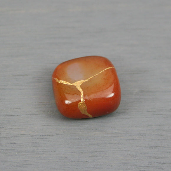 Small kintsugi repaired carnelian tumbled stone