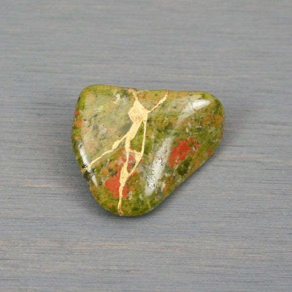 Small kintsugi repaired unakite tumbled stone