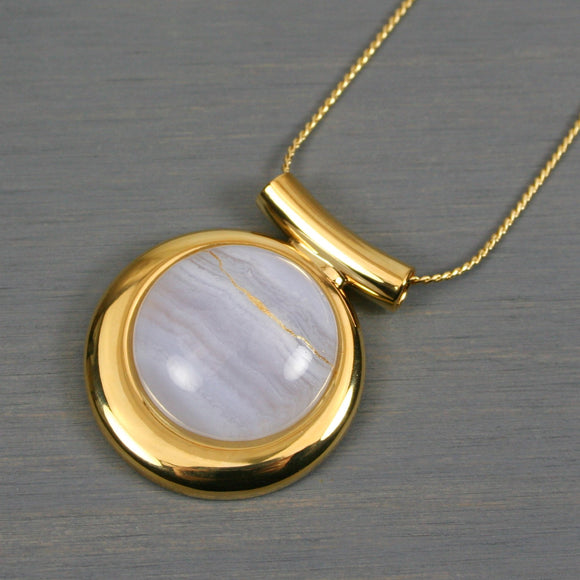 Blue lace agate kintsugi pendant in a gold setting on chain