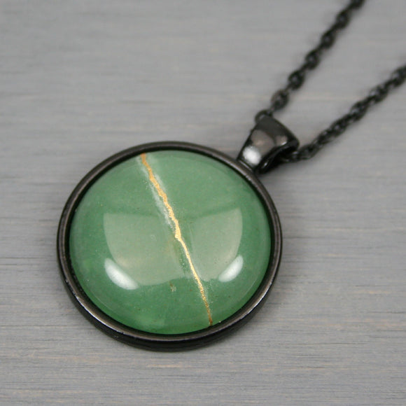 Green aventurine kintsugi pendant in black setting on chain