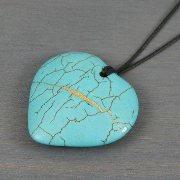 Turquoise howlite broken heart pendant with kintsugi repair on black cotton cord