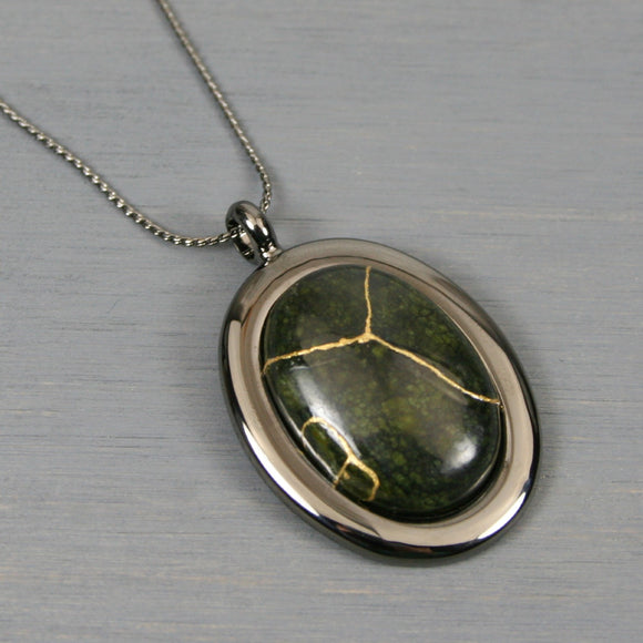 Russian serpentine kintsugi pendant in a gunmetal setting on chain