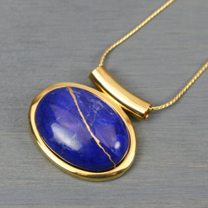 Lapis howlite kintsugi pendant in a gold setting on chain
