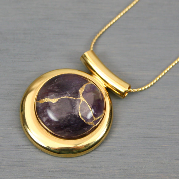 Amethyst kintsugi pendant in a gold setting on chain