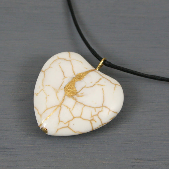 White howlite broken heart pendant with kintsugi repair on black cotton cord