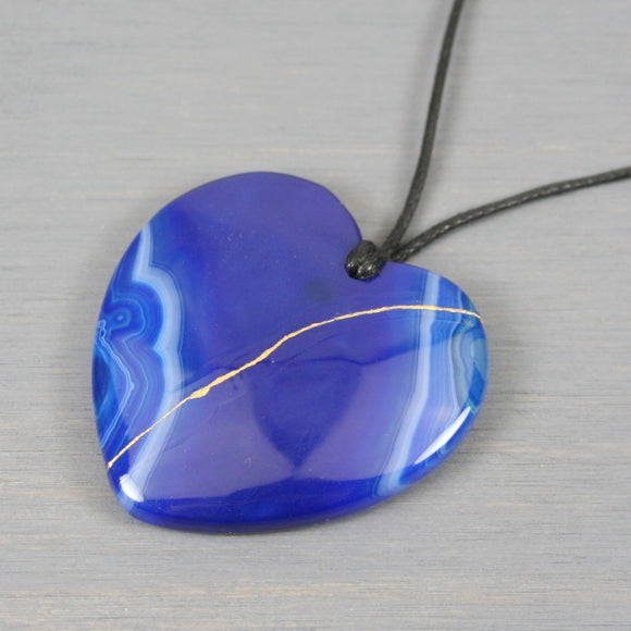Blue banded agate kintsugi heart pendant on black cotton cord