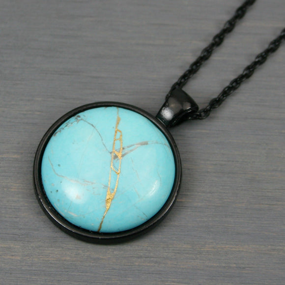 Turquoise howlite kintsugi pendant in black setting on chain