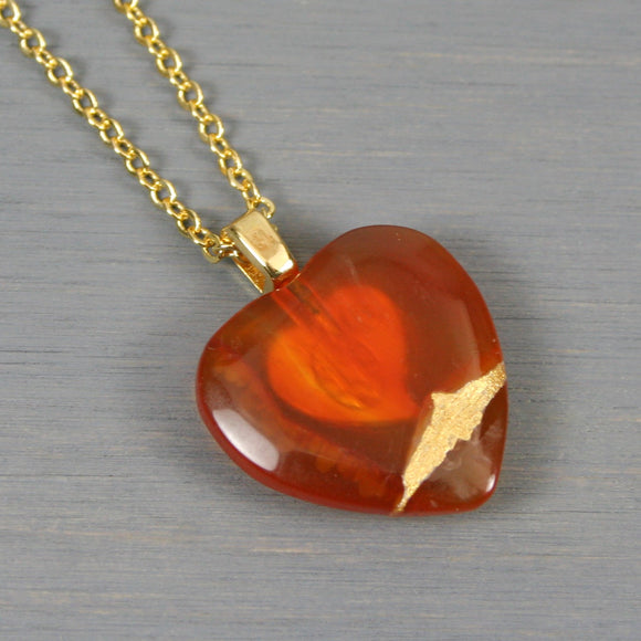 Red agate broken heart pendant with kintsugi repair on chain