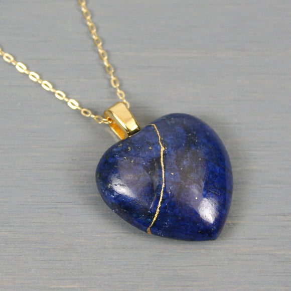 Lapis lazuli broken heart pendant with kintsugi repair on chain necklace
