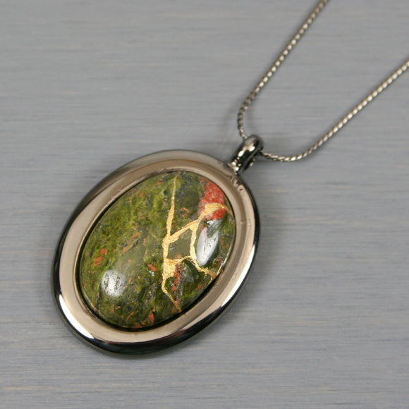 Unakite kintsugi pendant in a gunmetal setting on chain