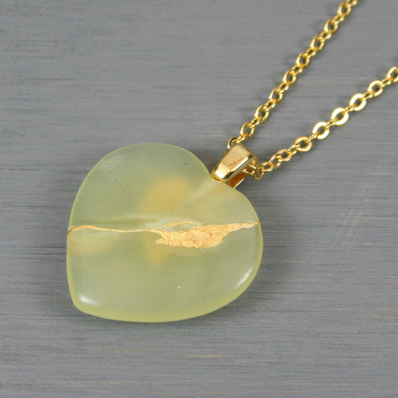 Light green stone broken heart pendant with kintsugi repair on chain necklace