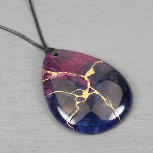 Dark purple dragon veins agate teardrop pendant with kintsugi repair on black cotton cord