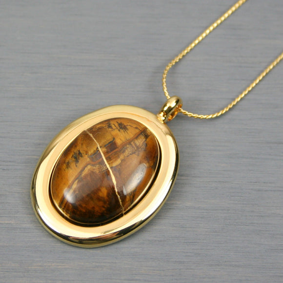Tiger eye kintsugi pendant in a gold setting on chain
