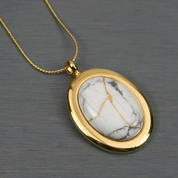 White howlite kintsugi pendant in a gold setting on chain