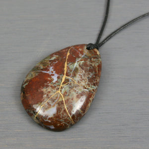 "Green ""opal"" (chalcedony) teardrop pendant with kintsugi repair on black cotton cord"