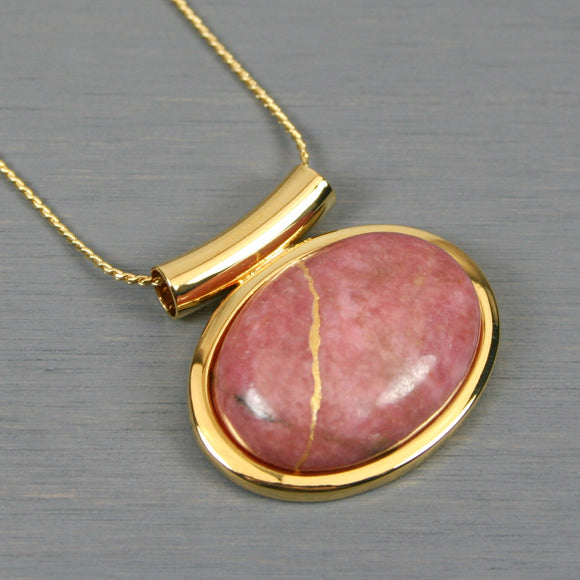 Rhodonite kintsugi pendant in a gold setting on chain