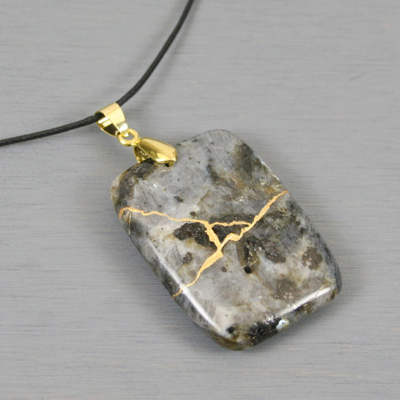 Blue labradorite (or larvikite) pendant with kintsugi repair on black cotton cord