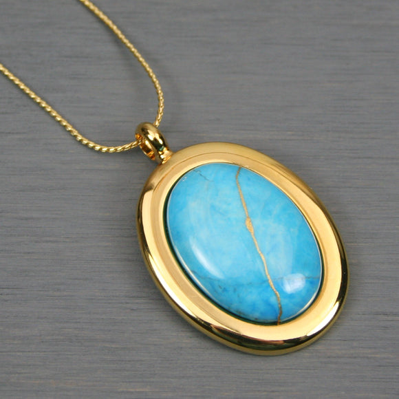 Turquoise howlite kintsugi pendant in a gold setting on chain