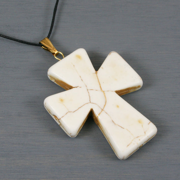 White howlite kintsugi cross pendant on black cotton cord necklace